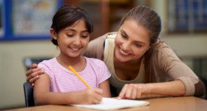 Maestro con alumno