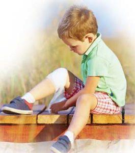 Boy_with_Hurt_Knee